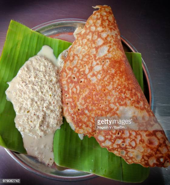 directly above shot of dosa served in plate - dosa stock photos and pictures