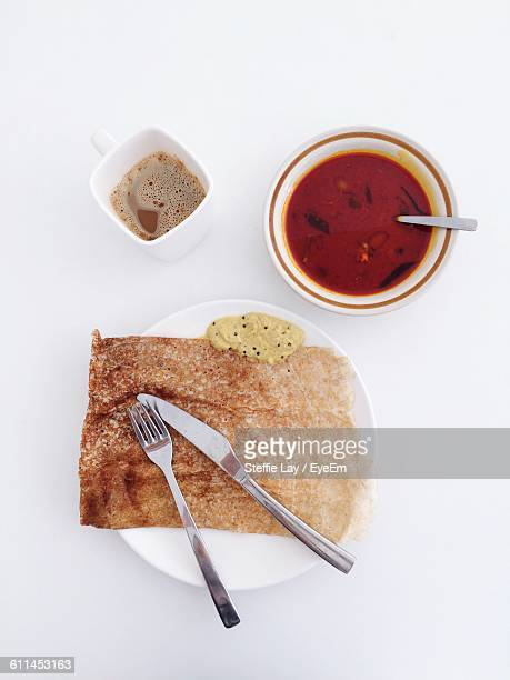 Directly Above Shot Of Dosa With Sambar And Coffee Served On Table