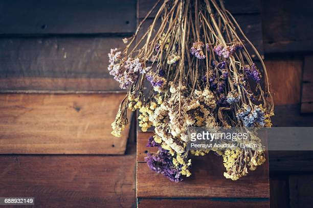 directly above shot of dried bouquet on wooden table - dried plant stock pictures, royalty-free photos & images