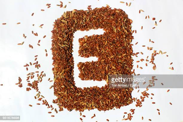 Directly Above Shot Of Dried Food With Alphabet E Over White Background