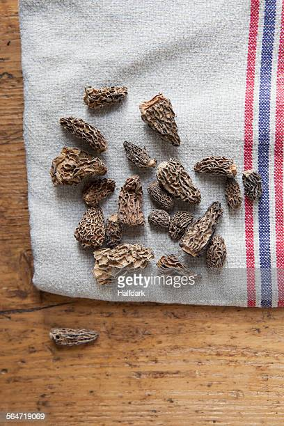Directly above shot of dried Morchella mushrooms on cloth