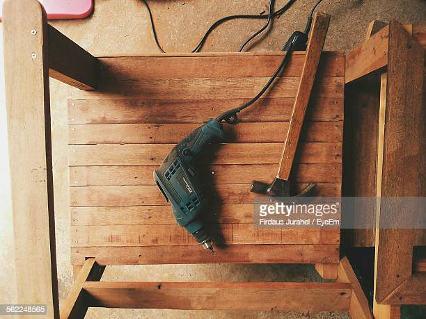 Directly Above Shot Of Drill Machine With Hammer On Table