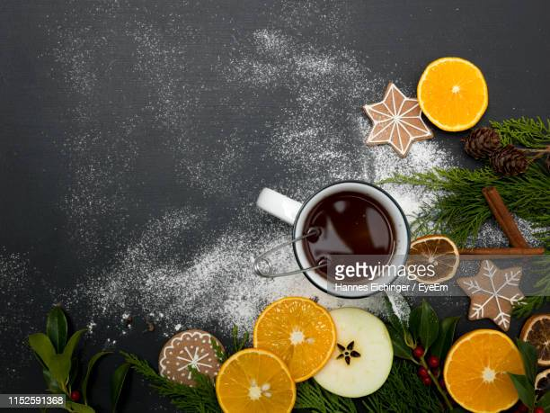 directly above shot of drink with fruits and spices on table - warme dranken stockfoto's en -beelden
