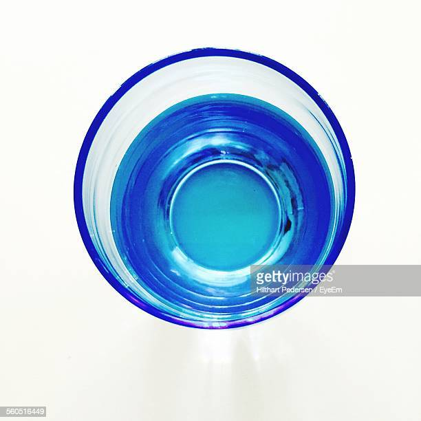 Directly Above Shot Of Drinking Glass Against White Background