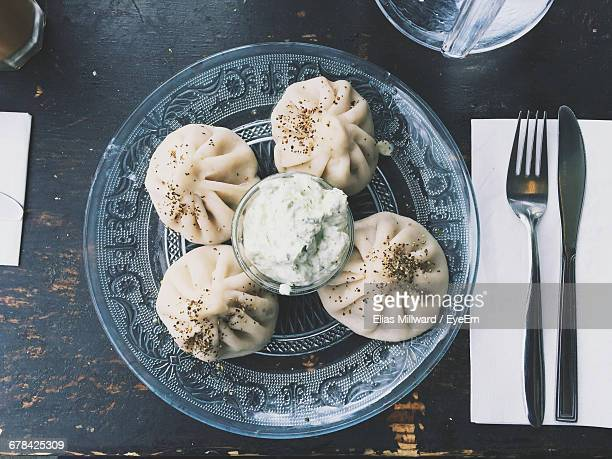 Directly Above Shot Of Dumplings Served In Glass Plate On Table