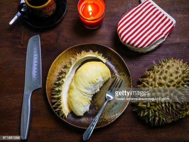 directly above shot of durian in plate on table - durian stock pictures, royalty-free photos & images