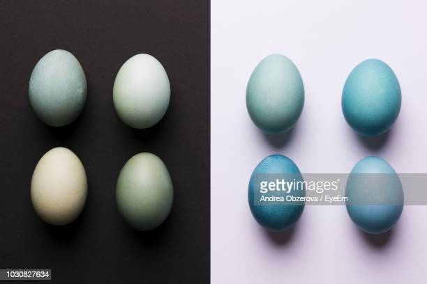 directly above shot of easter eggs on table - easter egg stock pictures, royalty-free photos & images