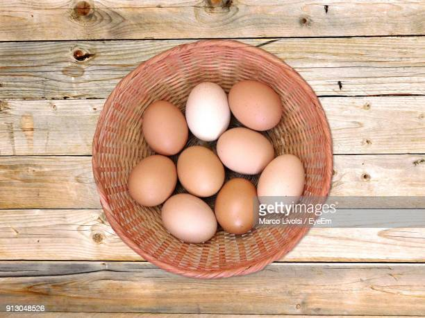Directly Above Shot Of Eggs In Basket On Table