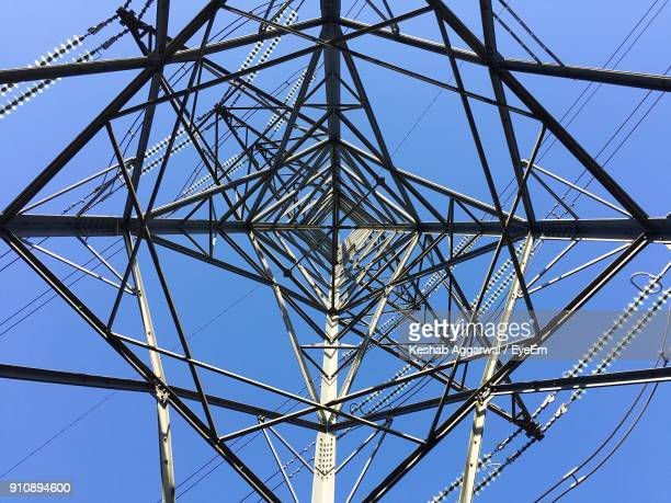 directly above shot of electricity pylon against clear blue sky - esher stock pictures, royalty-free photos & images