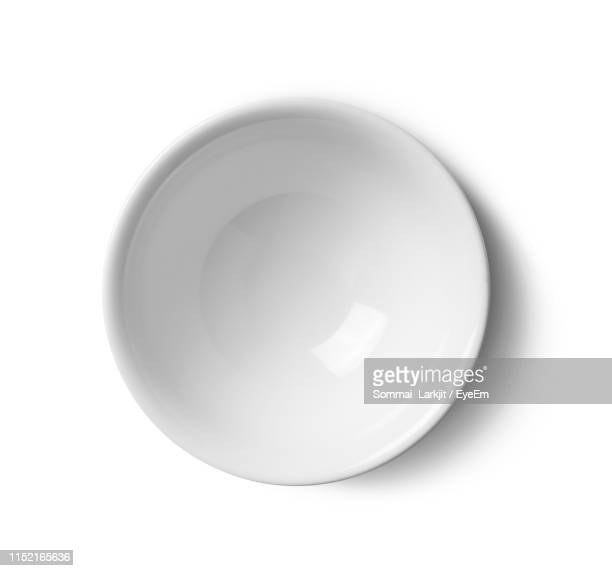 directly above shot of empty bowl against white background - 深皿 ストックフォトと画像