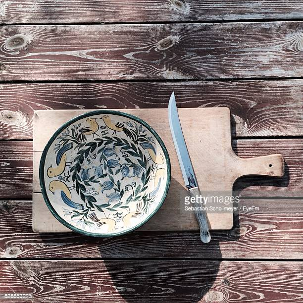 Directly Above Shot Of Empty Bowl And Knife On Table