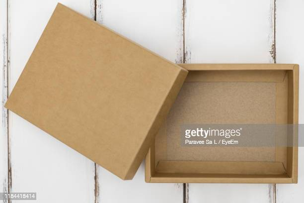 directly above shot of empty cardboard box on table - cardboard box stock pictures, royalty-free photos & images