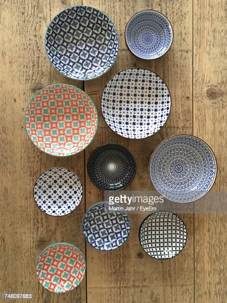 directly above shot of empty ceramics bowls on table - ceramic stock photos and pictures
