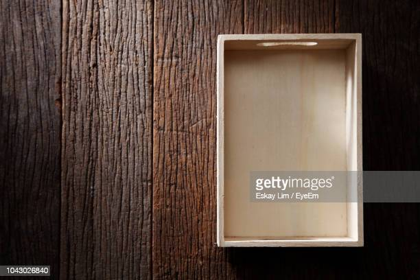 directly above shot of empty crate on wooden table - crate stock pictures, royalty-free photos & images