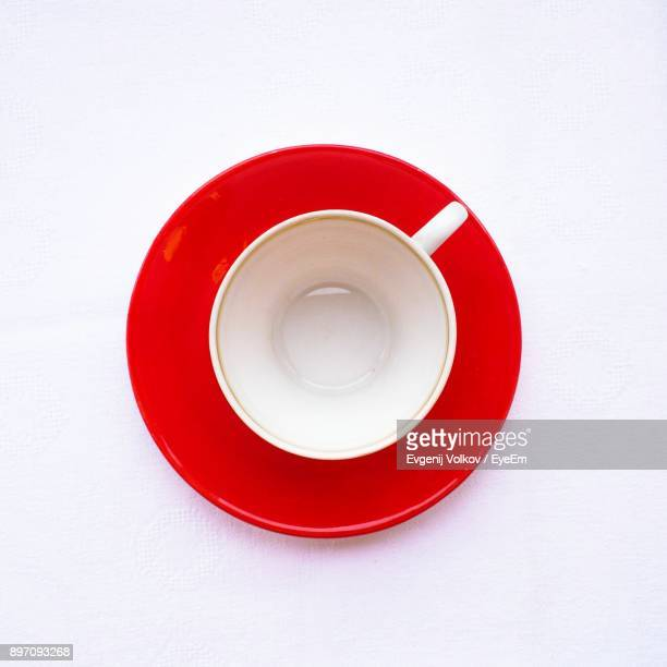 directly above shot of empty cup over white background - saucer stock pictures, royalty-free photos & images