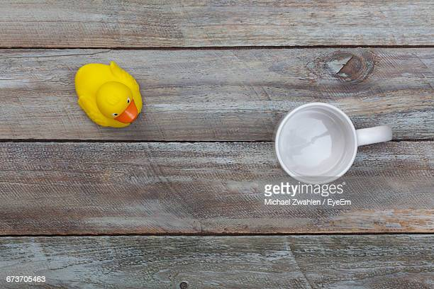 Directly Above Shot Of Empty Cup With Rubber Duck On Table