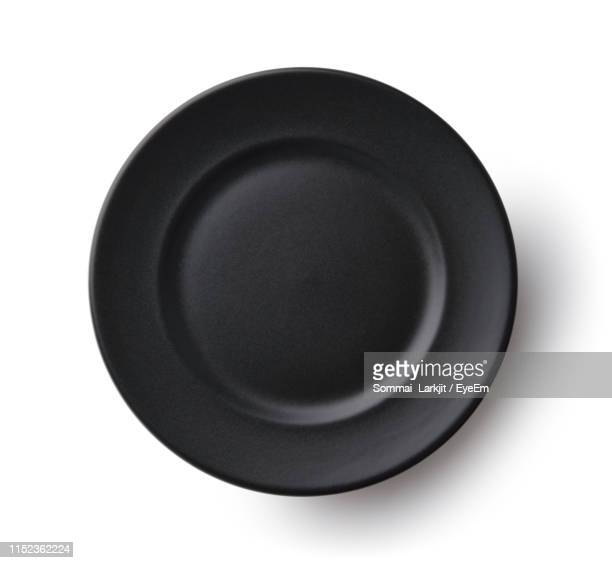 directly above shot of empty plate against white background - 皿 ストックフォトと画像