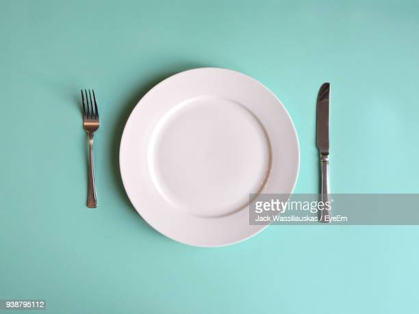 directly above shot of empty plate on table - silverware stock pictures, royalty-free photos & images