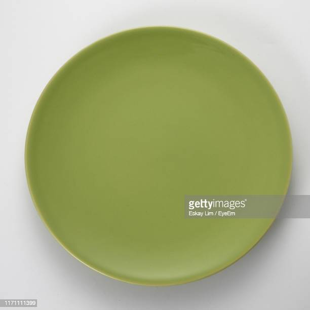 directly above shot of empty plate on white background - ceramic stock pictures, royalty-free photos & images