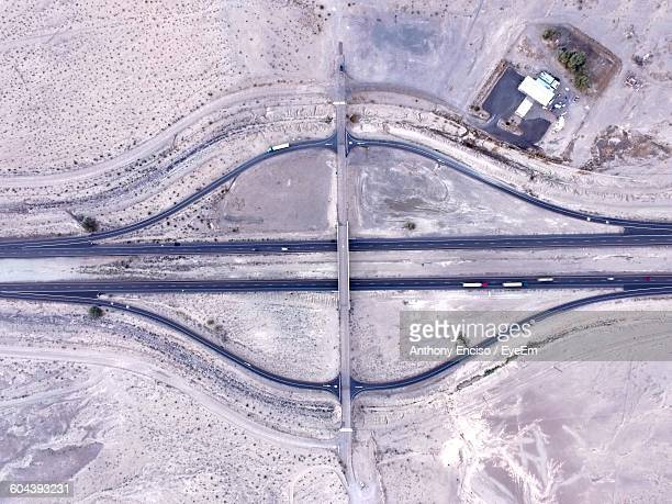 Directly Above Shot Of Empty Road Amidst Desert