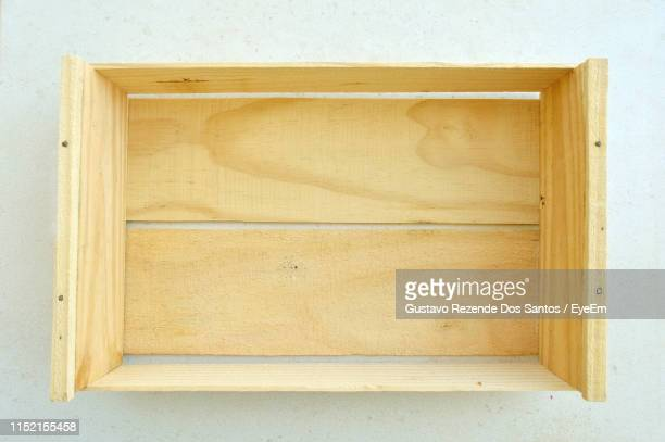 directly above shot of empty wooden box on table - crate stock pictures, royalty-free photos & images
