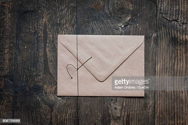 Directly Above Shot Of Envelop On Wooden Table