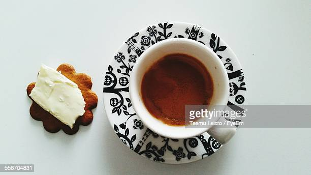 Directly Above Shot Of Espresso And Ginger Snap With Cheese Against White Background