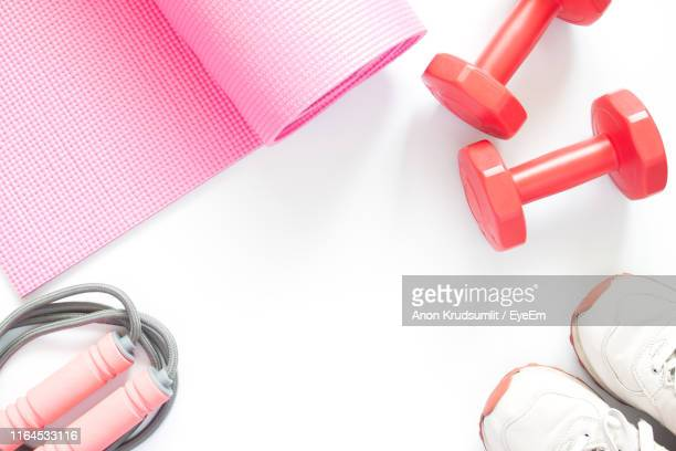 directly above shot of exercise equipment against white background - エクササイズマット ストックフォトと画像