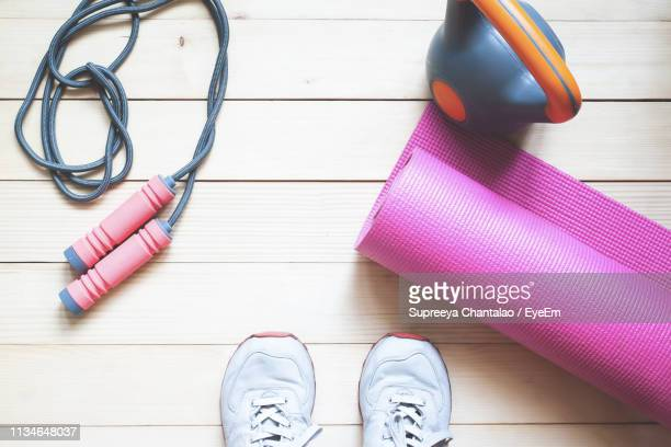 directly above shot of exercise equipment on hardwood floor - mat stock pictures, royalty-free photos & images