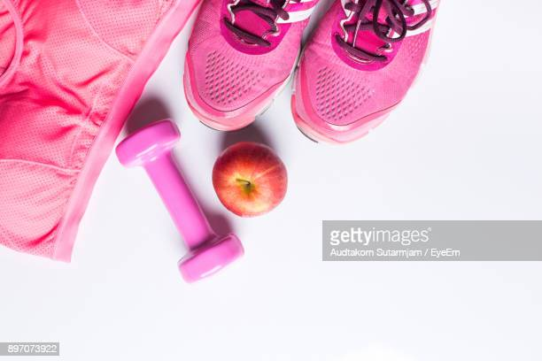 directly above shot of exercising equipment on white background - exercise equipment stock pictures, royalty-free photos & images