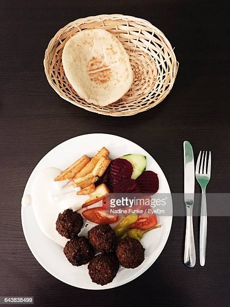 Directly Above Shot Of Falafel With Vegetables And Flatbread Served On Table