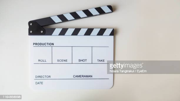 directly above shot of film slate on table - clapboard stock pictures, royalty-free photos & images