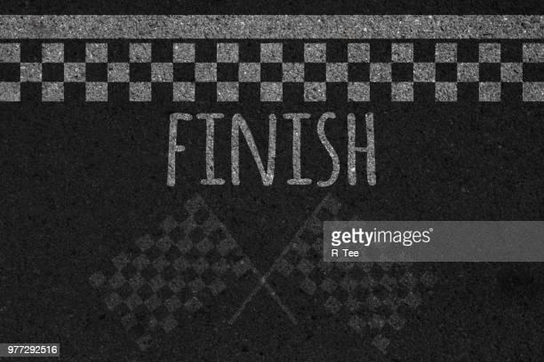 directly above shot of finish line - ziellinie stock-fotos und bilder