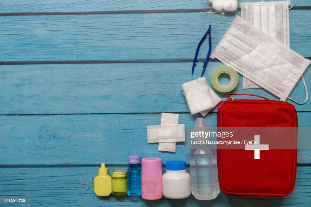 Directly Above Shot Of First Aid Kit On Table : Stock Photo