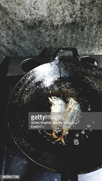 Directly Above Shot Of Fish Frying In Cooking Pan