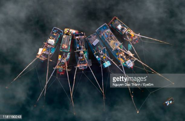 directly above shot of fishing boats in sea during foggy weather - halong bay imagens e fotografias de stock