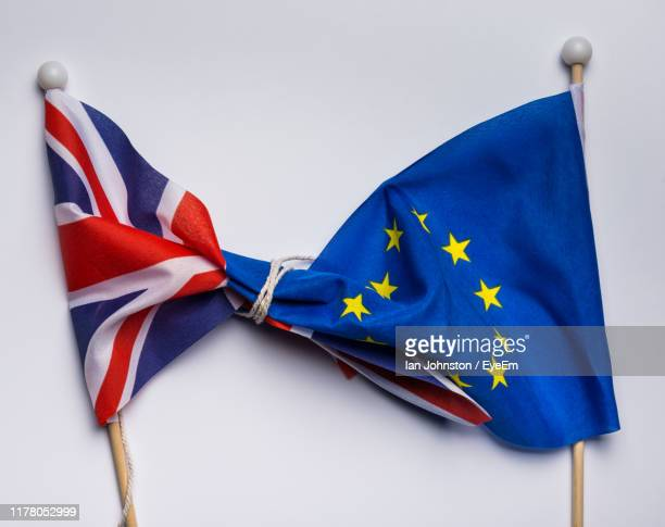directly above shot of flags tied on gray background - brexit stock pictures, royalty-free photos & images