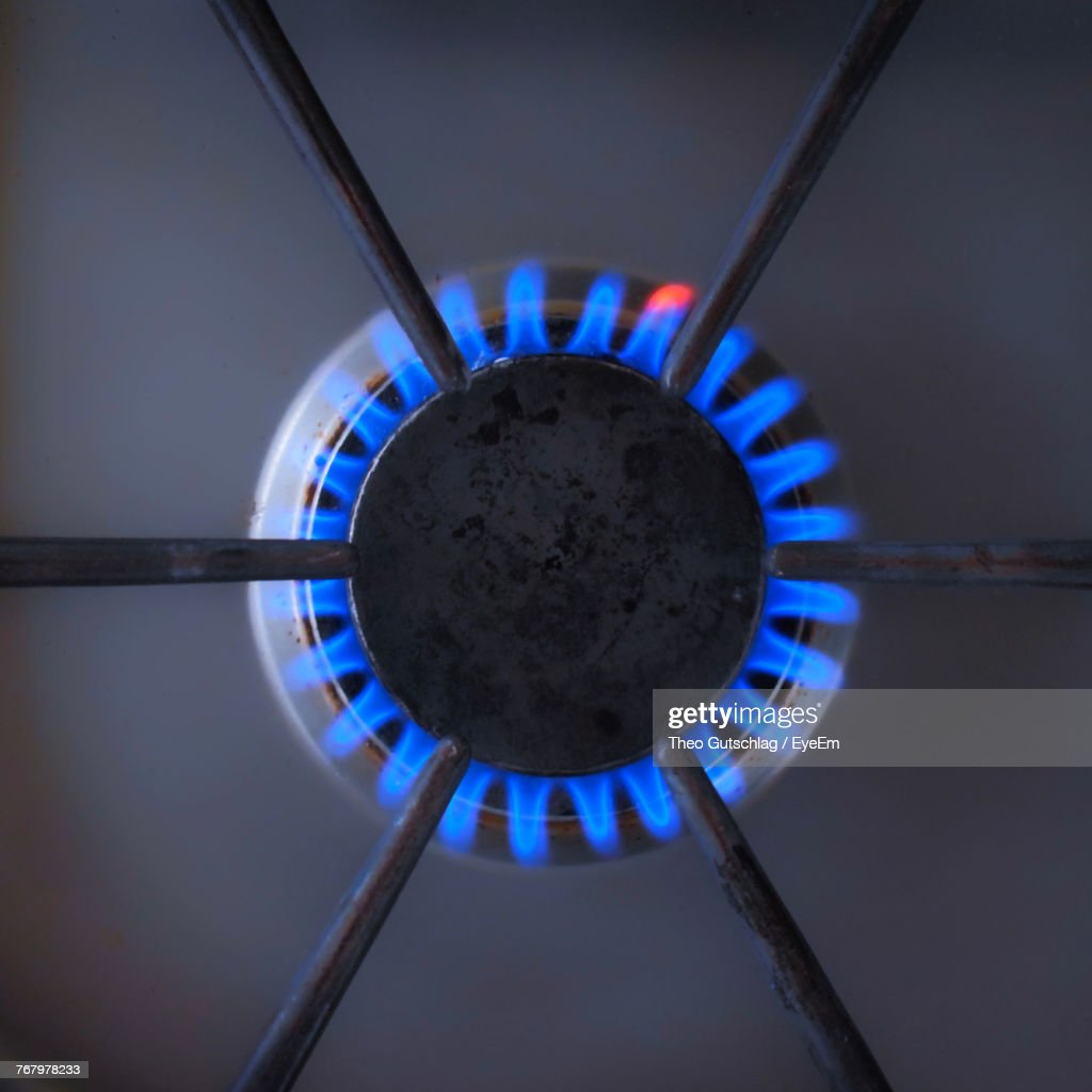 Directly Above Shot Of Flame On Gas Stove Burner : Stock Photo