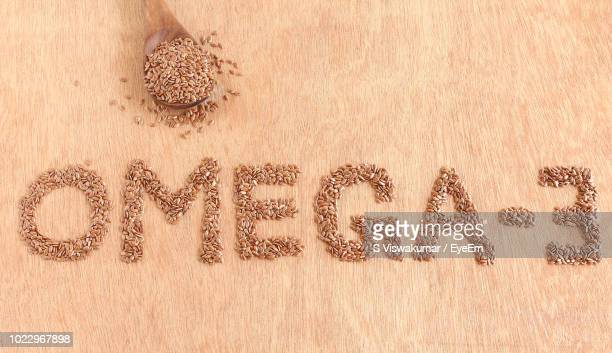 directly above shot of flax seeds on table - omega 3 stock pictures, royalty-free photos & images