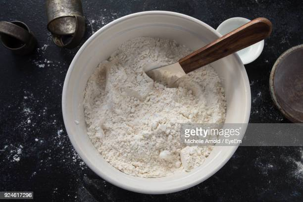 directly above shot of flour in bowl on table - flour stock pictures, royalty-free photos & images