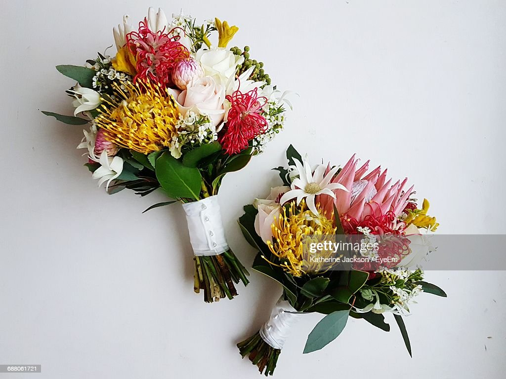 Directly Above Shot Of Flower Bouquets On White Background : Stock Photo