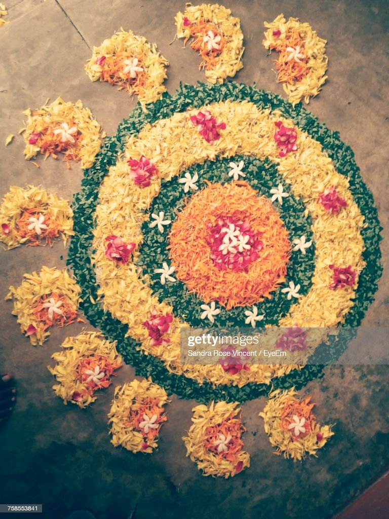 Directly Above Shot Of Flower Rangoli On Floor : Stock Photo
