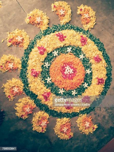 directly above shot of flower rangoli on floor - rangoli stock pictures, royalty-free photos & images
