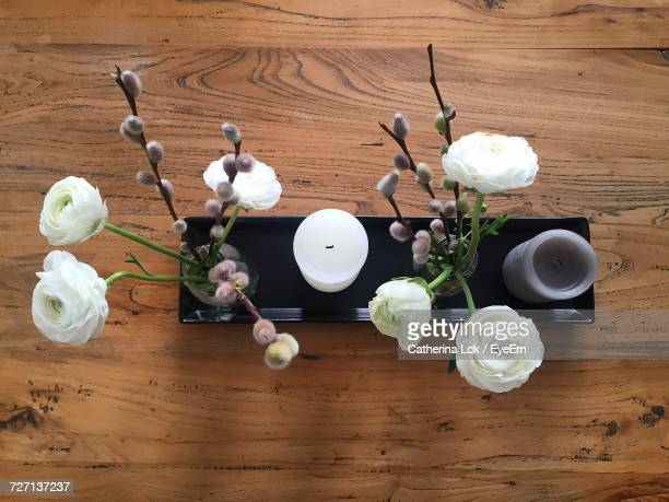 Directly Above Shot Of Flower Vases With Candles On Table