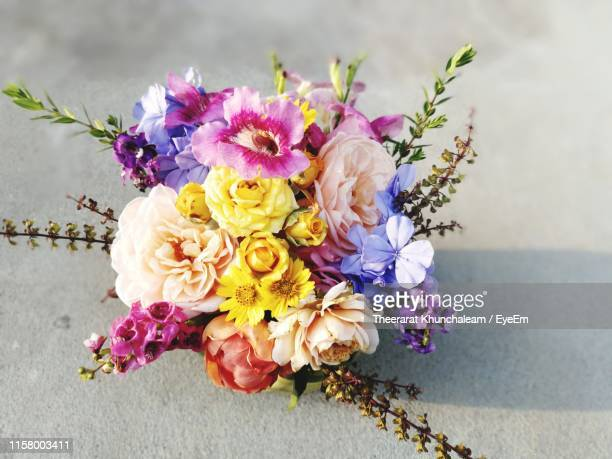 directly above shot of flowers on table - purple roses bouquet ストックフォトと画像