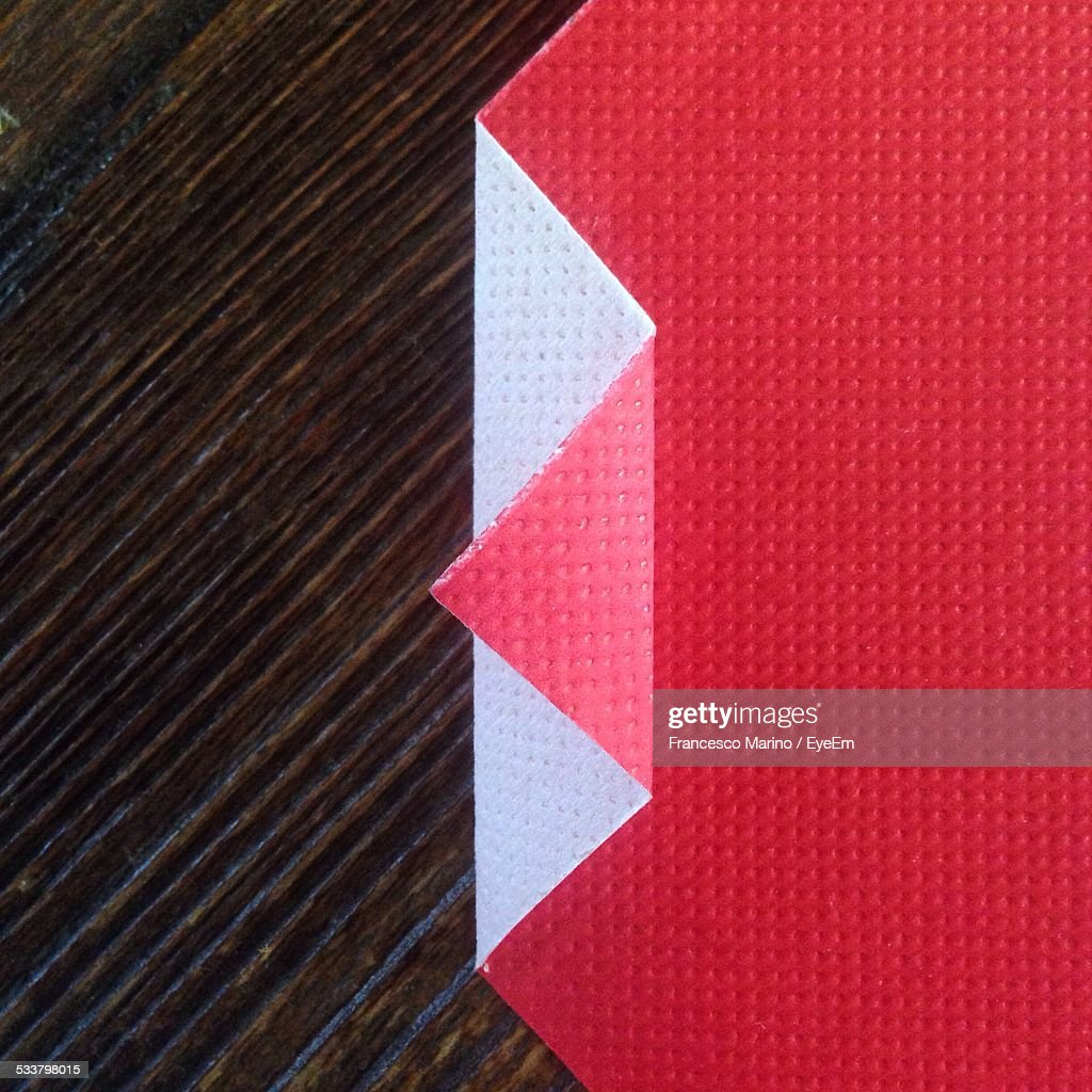 Directly Above Shot Of Folded Red Paper On Table : Foto stock