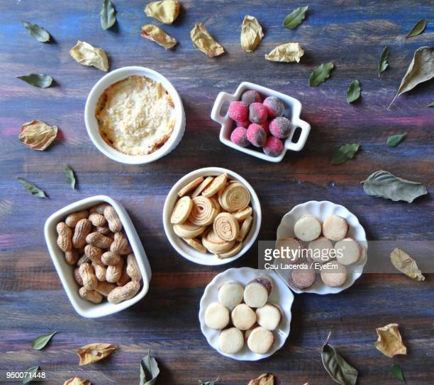 directly above shot of food amidst leaves on wooden table - brazil nut fotografías e imágenes de stock