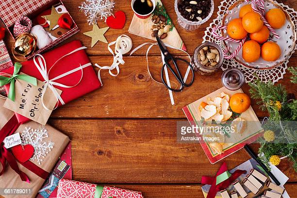 Directly above shot of food and Christmas decorations on wooden table
