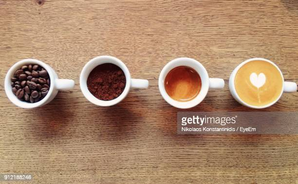 directly above shot of food and drinks on wooden table - ground coffee stock photos and pictures
