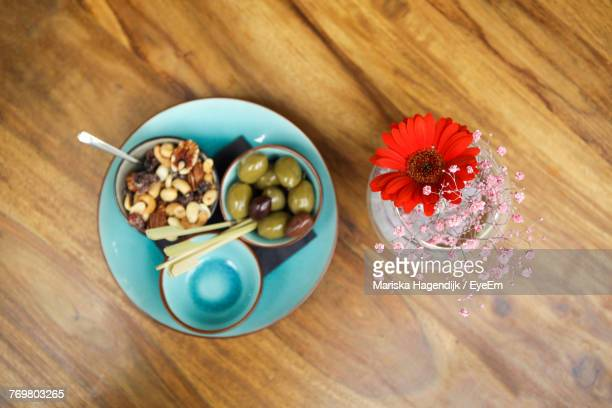 Directly Above Shot Of Food And Flower On Wooden Table